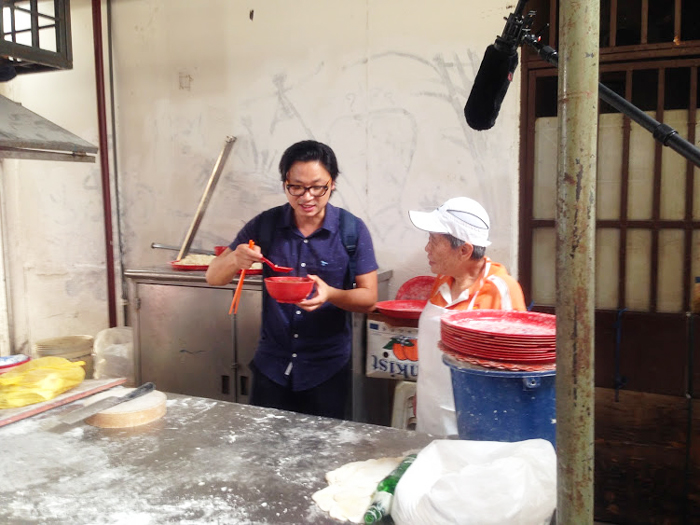 Luke tasting the freshly hand-rolled noodles by this 75 year old lady!